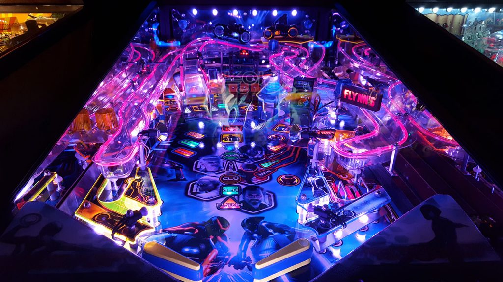 TRON pinball machine with LEDs and fiber optic ramps.
