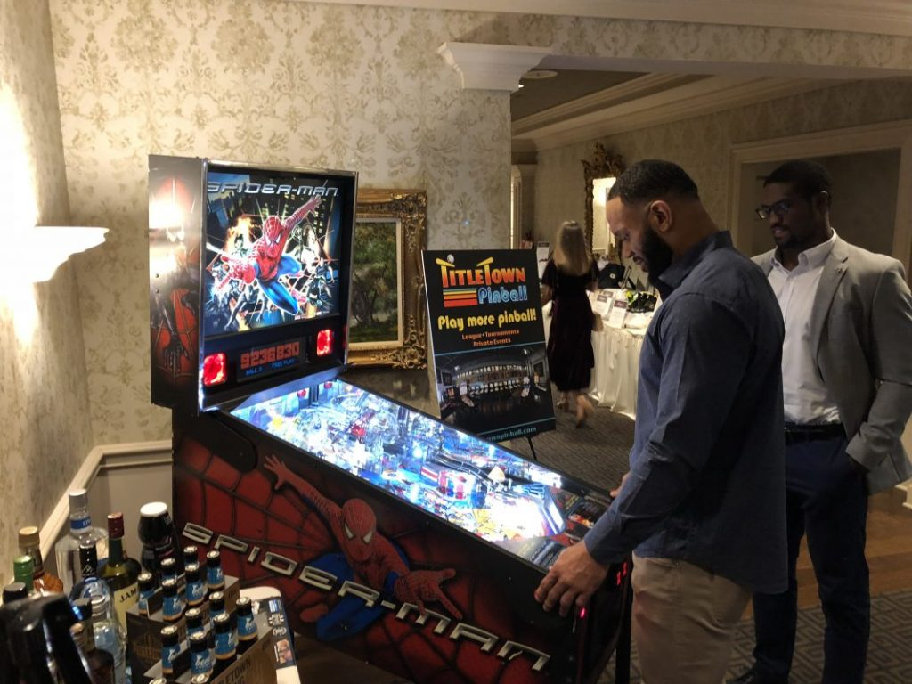 Green Bay Packers Lance Kendricks Playing Spiderman Pinball at Touchdowns for Hope 10-5-18.