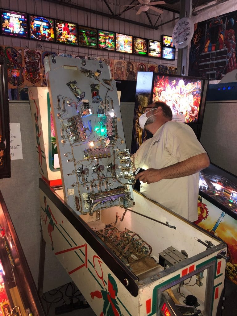 Fixing Volley Pinball Machine during Tournament Green Bay, WI